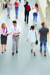 Busy Hallway In College With Students
